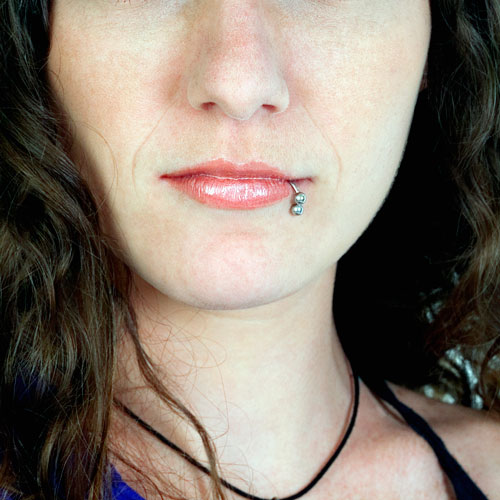 A woman with a lip piercing.