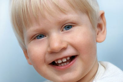 A young boy happy with his dental sealant treatment.
